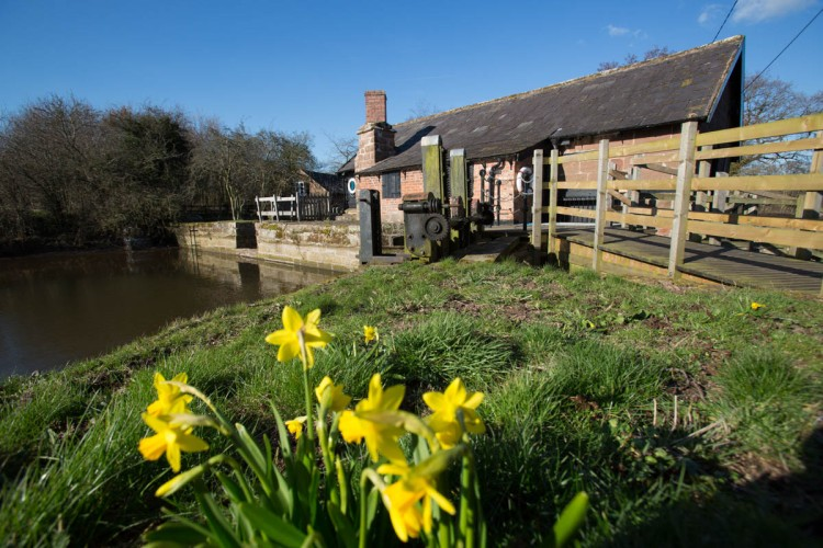 Picturesque spring view of the south façade of Stretton Watermill.