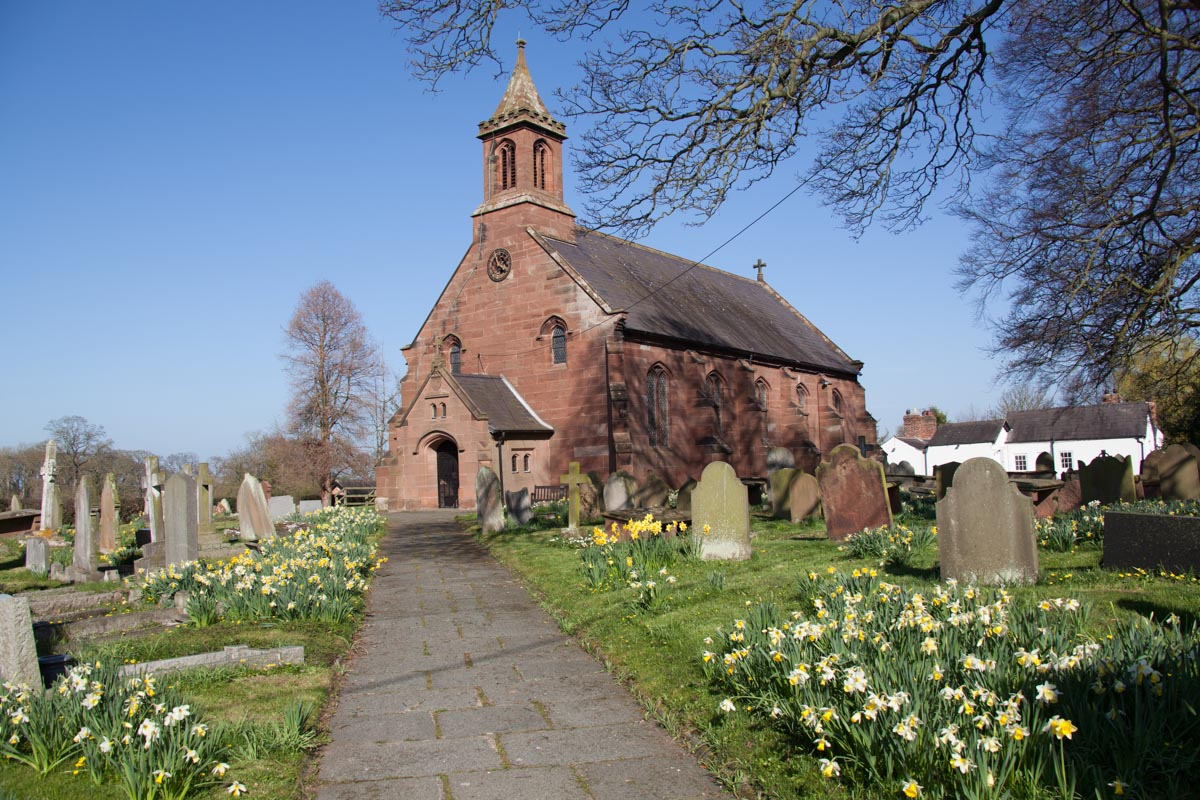 Spring view of the 19th century sandstone built St Mary's Church, located in the Cheshire village of Coddington.