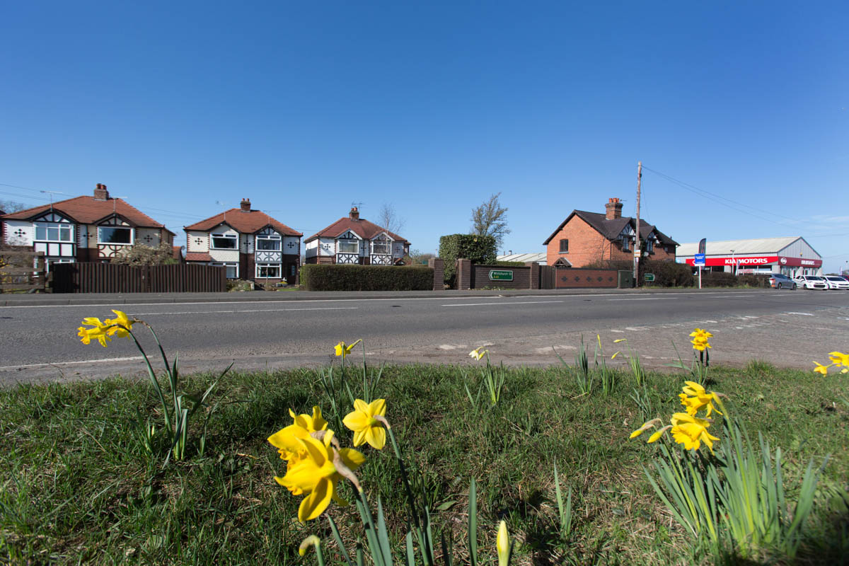 Picturesque spring view of the A41 road at Milton Green.