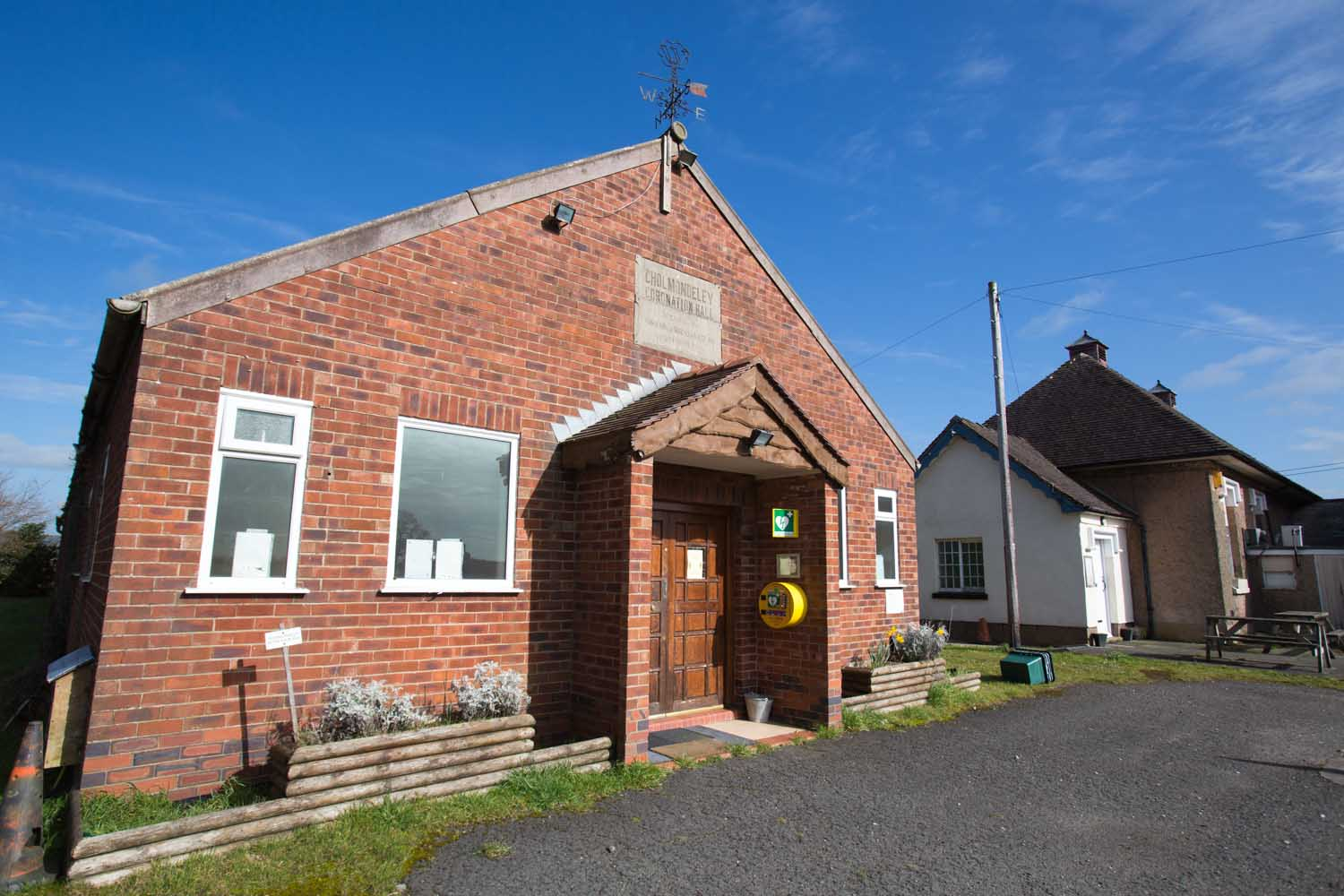 Picturesque view of Cholmondeley Coronation Hall, in the Cheshire village of Bickley.