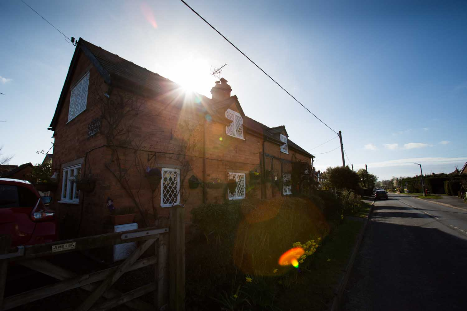 Picturesque silhouetted view of Cross O' Th' Hill Road, in the Cheshire village of No Man's Heath.