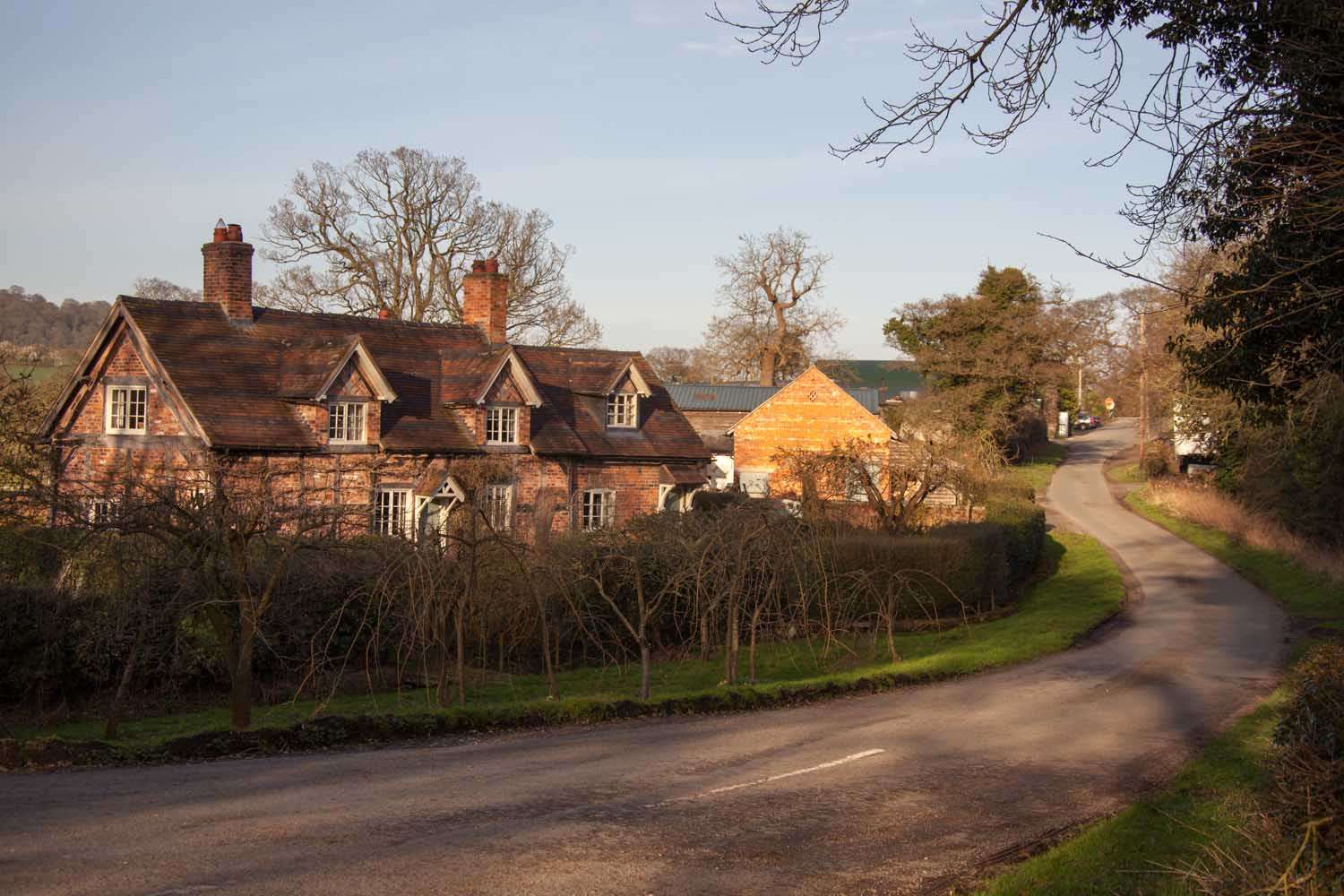 Picturesque view of a quiet rural lane at Cheshire's Edge Green.
