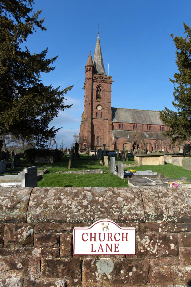 Village of Aldford, England. Picturesque view of the St John the Baptist's Church in Church Lane. The mid-19th century Grade II listed St John the Baptist's Church was commissioned by Richard Grosvenor, the 2nd Marquess of Westminster, and was designed by John Douglas.