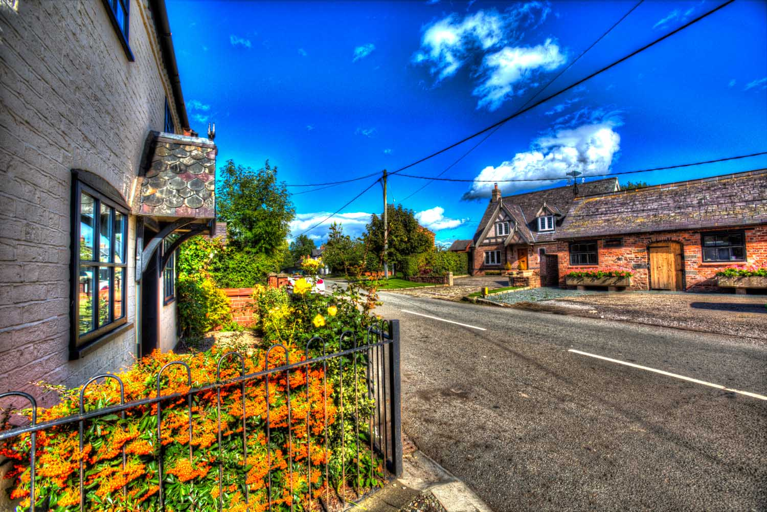Village of Shocklach, Cheshire, England. Artistic view of the B5069 main road through the village of Shocklach.