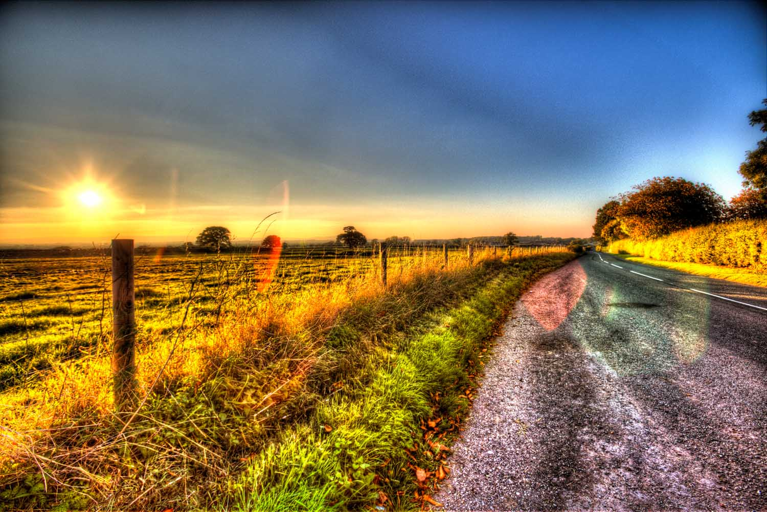 Village of Shocklach, Cheshire, England. Artistic sunset view over a rural road and Cheshire field, near the village of Shocklach.