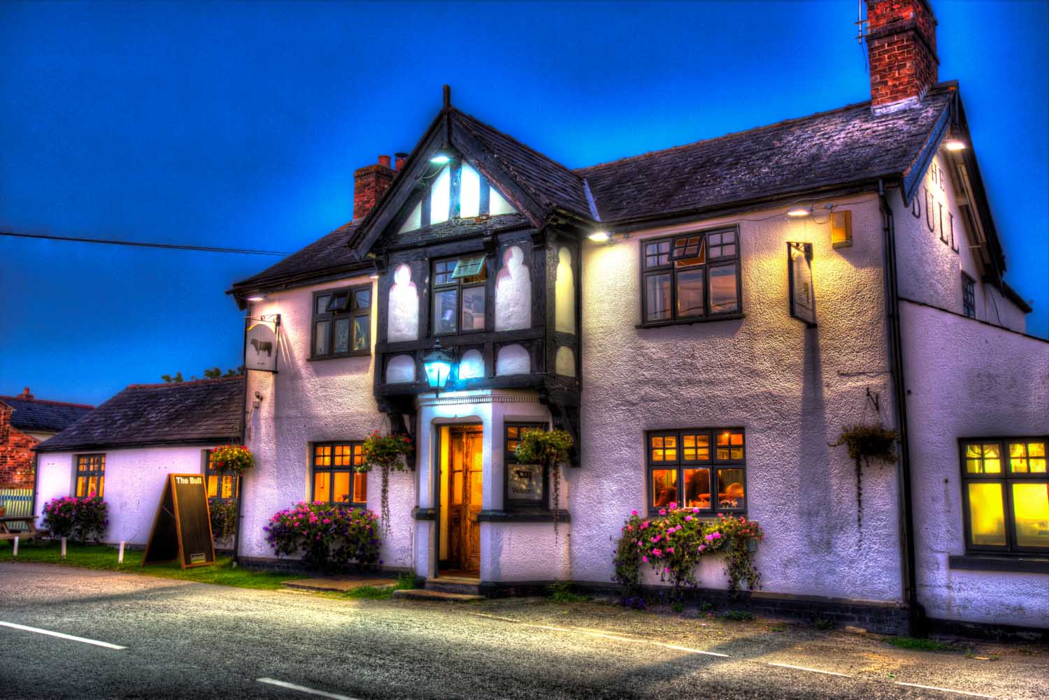 Village of Shocklach, Cheshire, England. Artistic evening view of the Bull Inn public house in the Cheshire village of Shocklach.