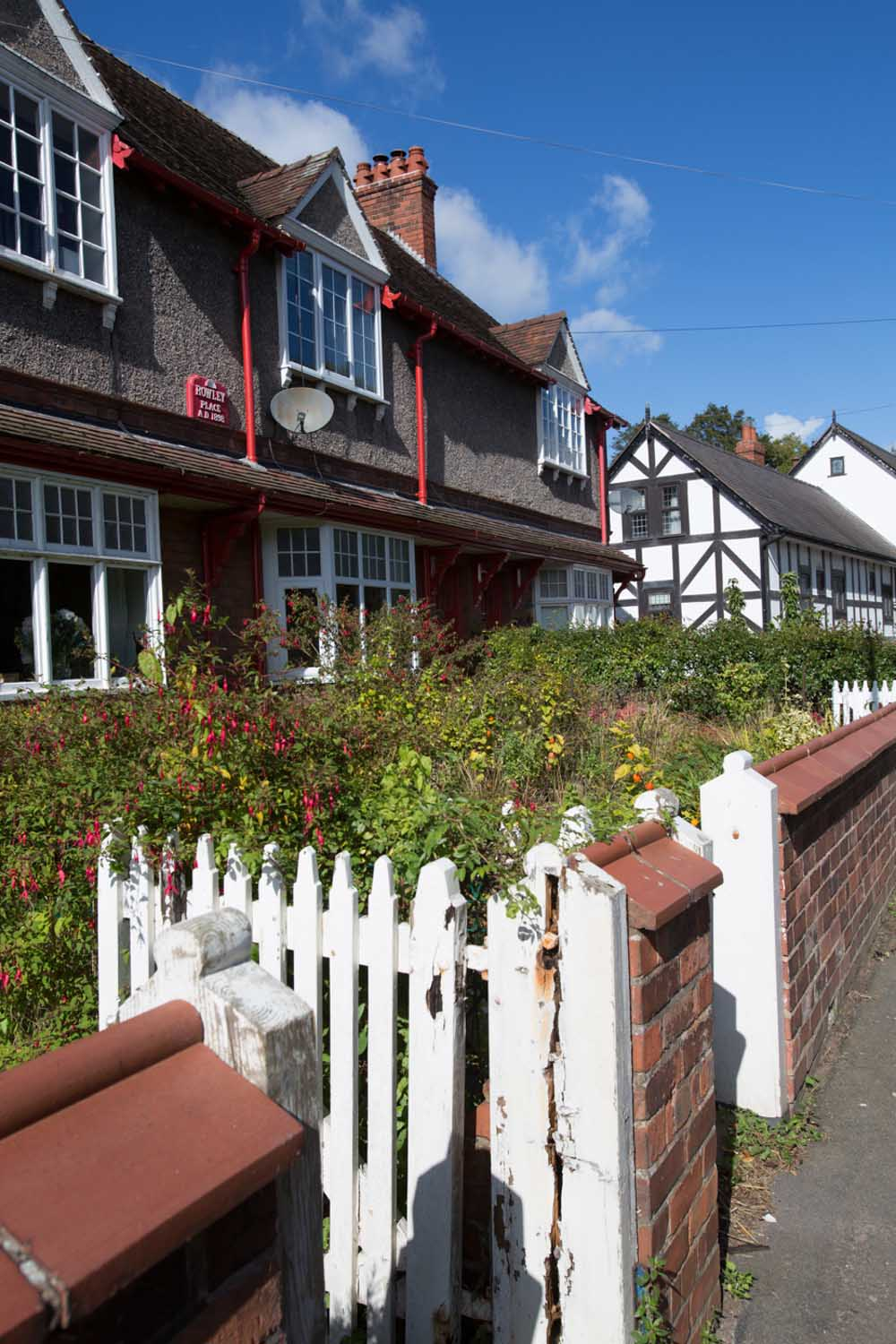 Village of Churton, Cheshire, England. Picturesque view of Victorian terraced houses on Churton's Chester Road.