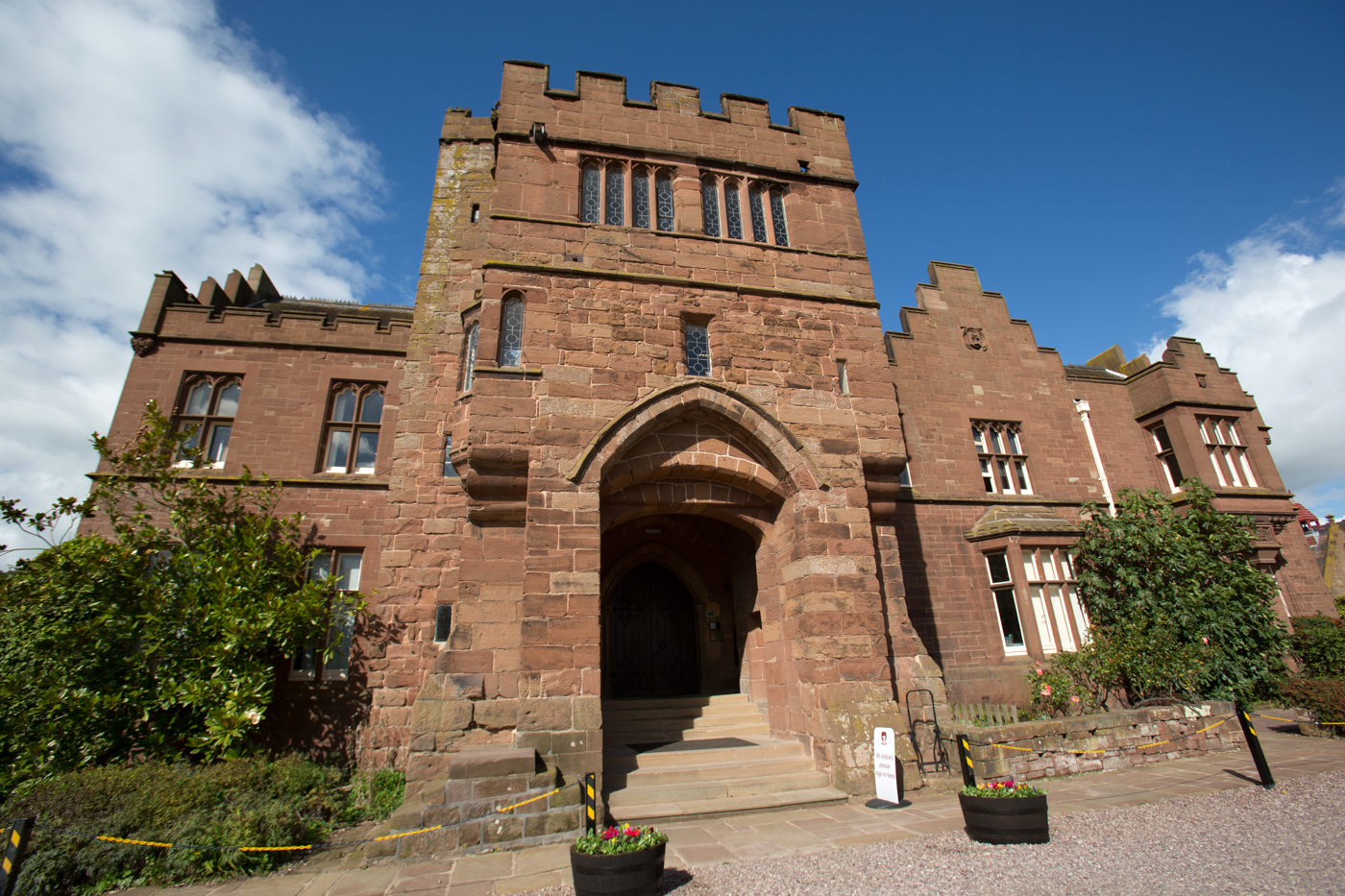 Village of Saighton, Cheshire, England. Picturesque view of the historic, Grade I listed, Abbey Gate College Gatehouse.