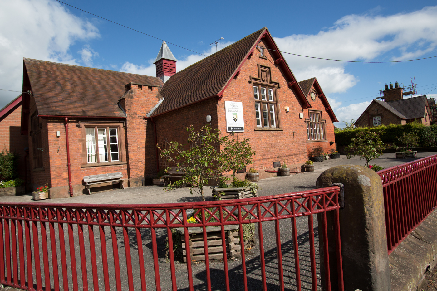 Village of Saighton, Cheshire, England. Picturesque view of Saighton's Church of England Primary School. The majority of the properties in the village belong to the Duke of Westminster Estate.