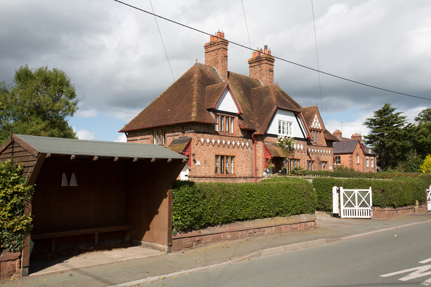 Village of Saighton, Cheshire, England. Picturesque view of houses on Saighton's, Saighton Lane. The majority of the properties in the village belong to the Duke of Westminster Estate.